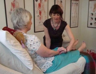 Traditional Chinese Medicine Clinic Treating Patient